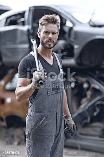 498879174 istock photo Male mechanic at junkyard 498879426