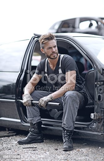 498879174 istock photo Male mechanic at junkyard 498879548