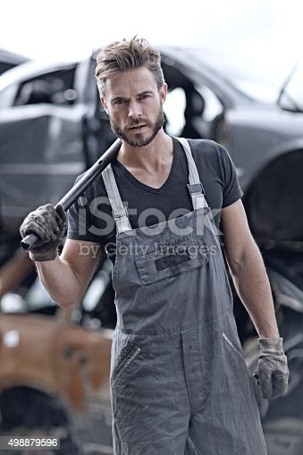 498879174 istock photo Male mechanic at junkyard 498879596