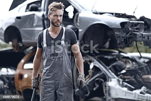 498879174 istock photo Male mechanic at junkyard 498879624