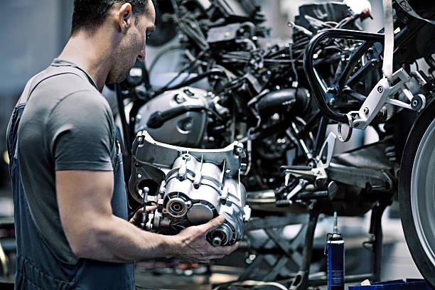 male mechanic in a repair workshop stock photo