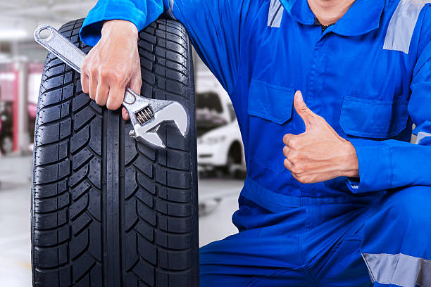 Male mechanic showing thumb up in workshop stock photo