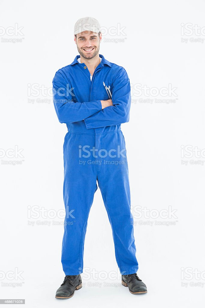 Male mechanic standing arms crossed on white background stock photo