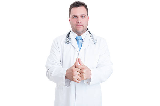 male medic or doctor cracking his knuckles like feeling ready - knuckle stock photos and pictures