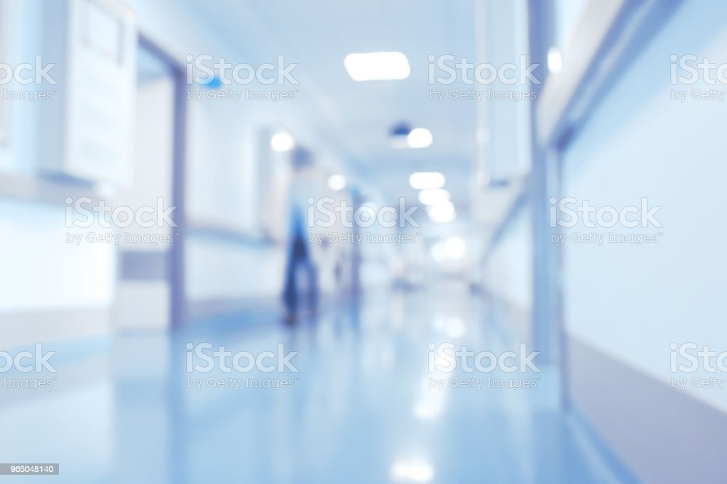 Male medical doctor in the bright hospital lobby, unfocused background royalty-free stock photo