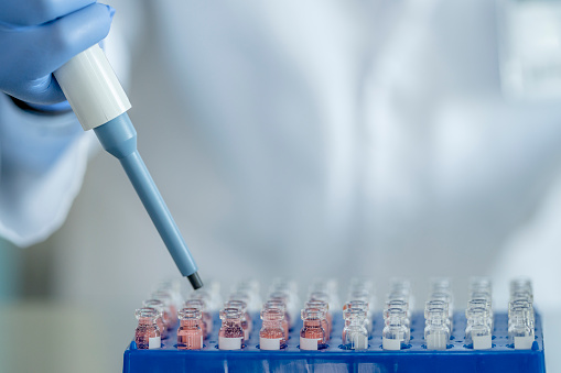 A male in his 30s of Indian ethnicity, working in a scientific laboratory searching for a vaccine for COVID-19.