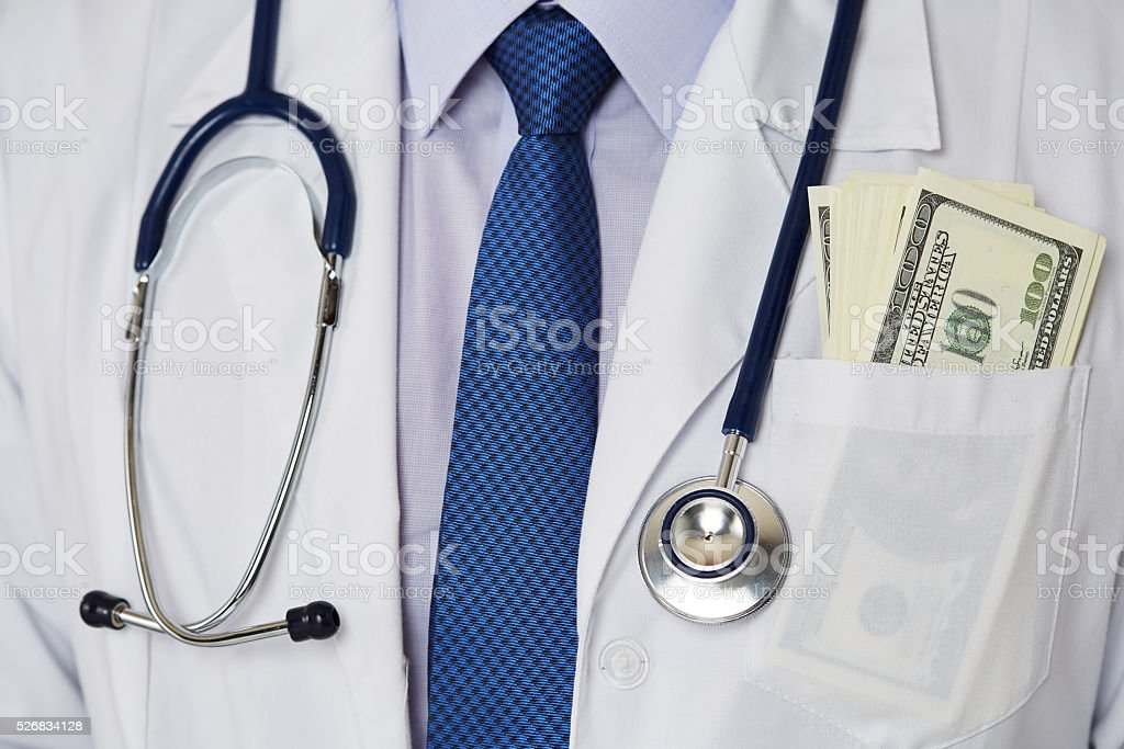 Male medicine doctor chest with bunch of hundred dollars banknot stock photo