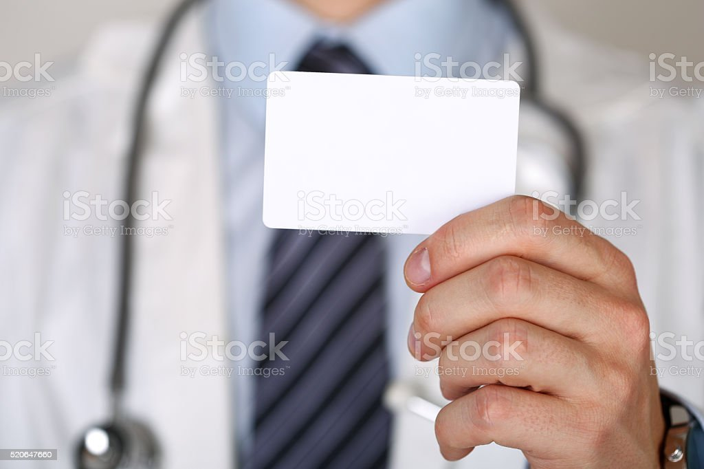 Male medicine doctor hand holding blank calling card stock photo
