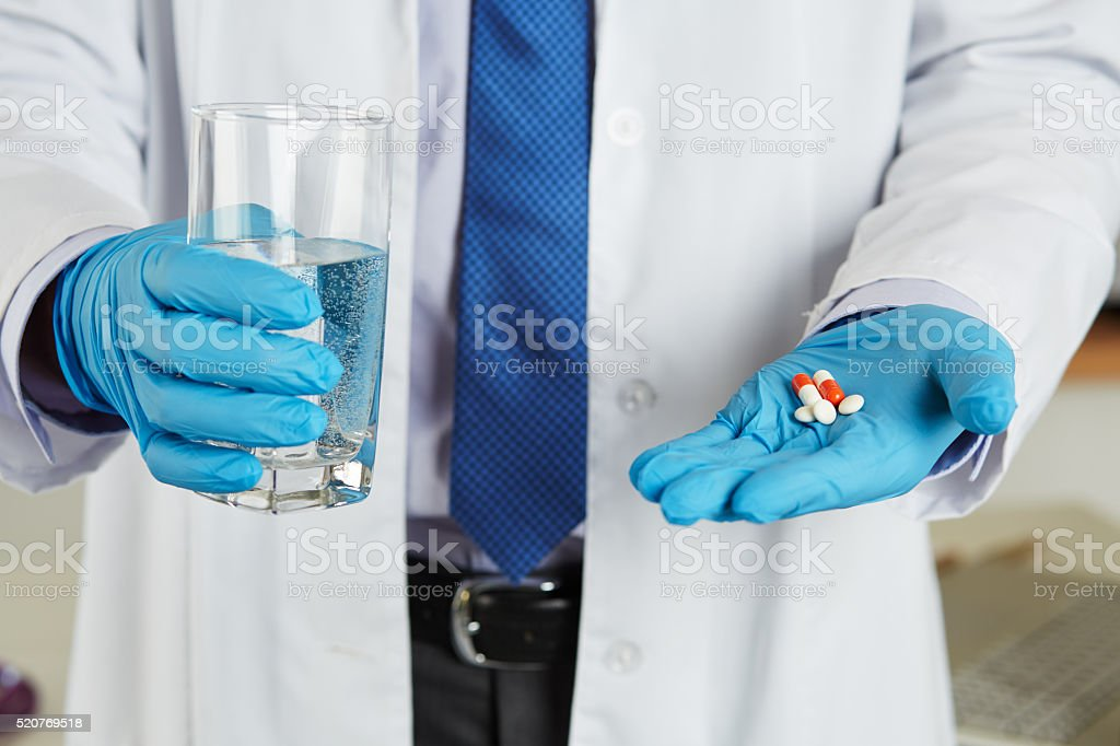 Male medicine doctor hands in blue gloves stock photo