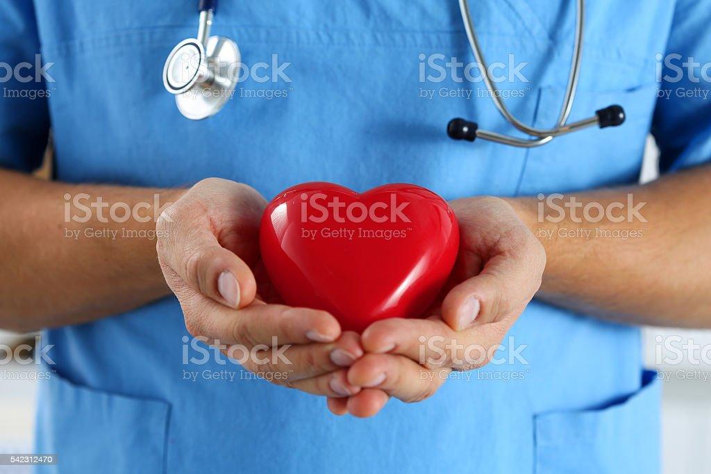 Male medicine doctor wearing blue uniform hold stock photo
