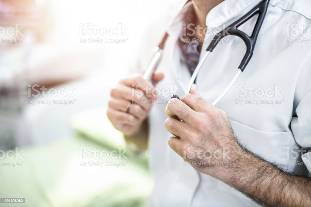 Male mid adult healthcare worker ready for action. stock photo