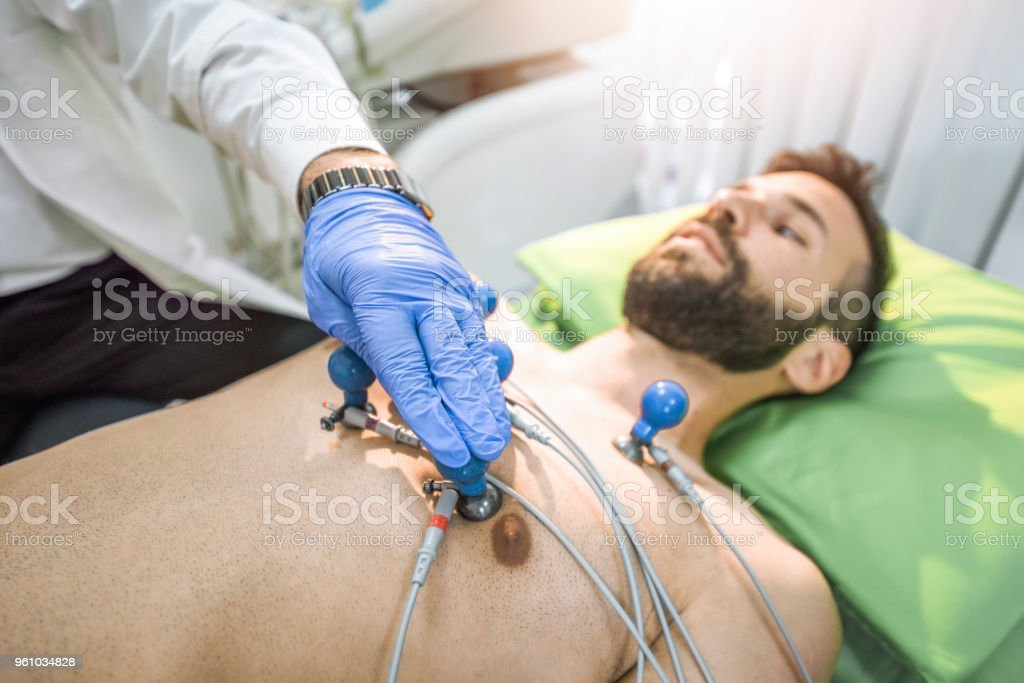 Male mid adult patient having his pulse traced. stock photo