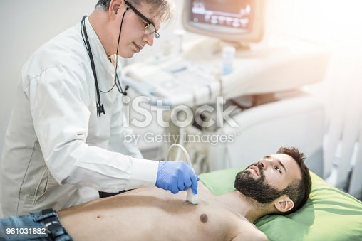 istock Male mid adult patient on ultrasound. 961031682