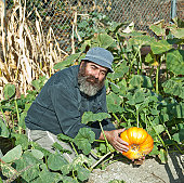 This male model is showing his prize pumpkin