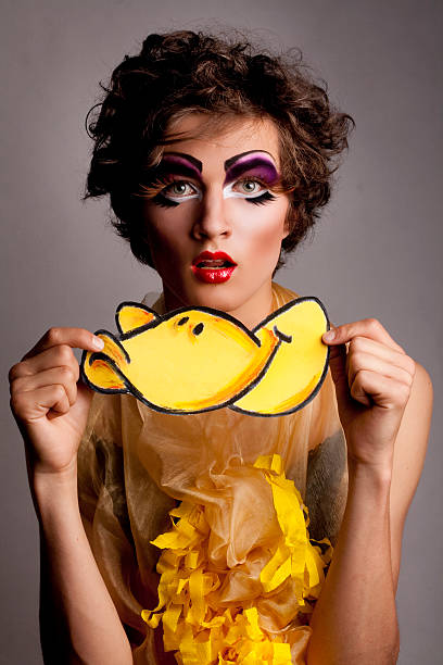 male model man looking like woman dressed weird duck - drag queen stockfoto's en -beelden