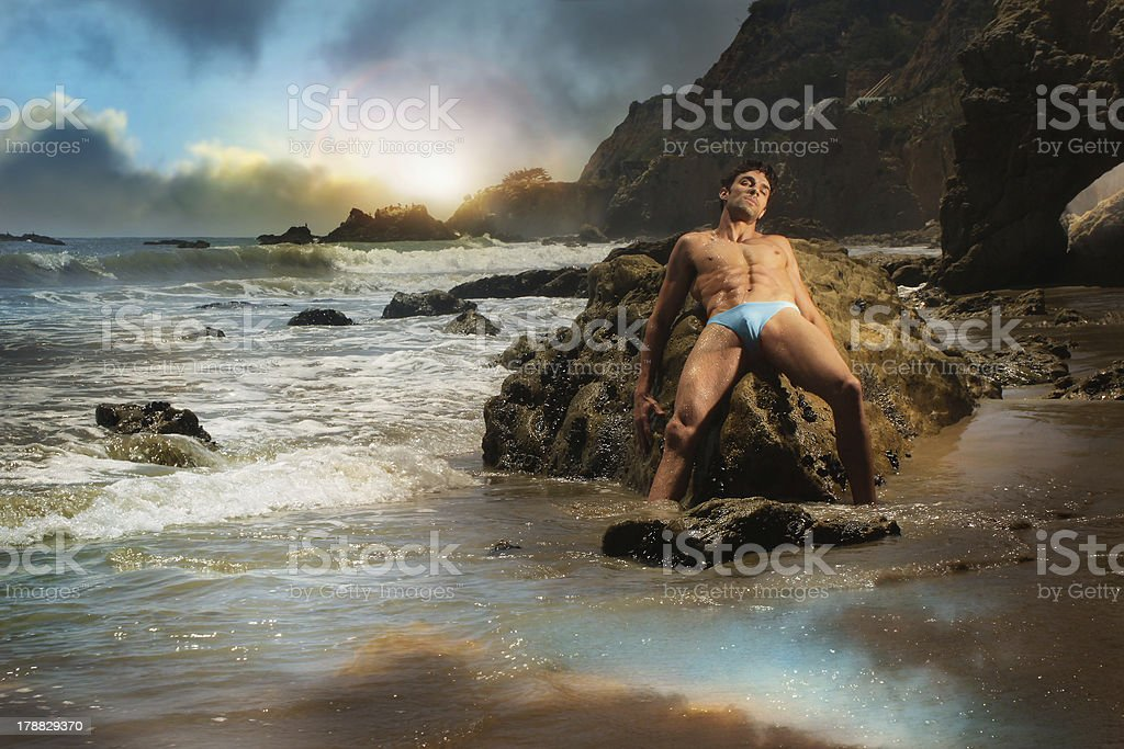 Male model on beach royalty-free stock photo