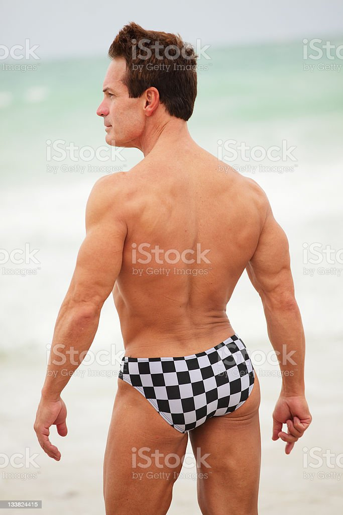 Male model posing on the beach stock photo