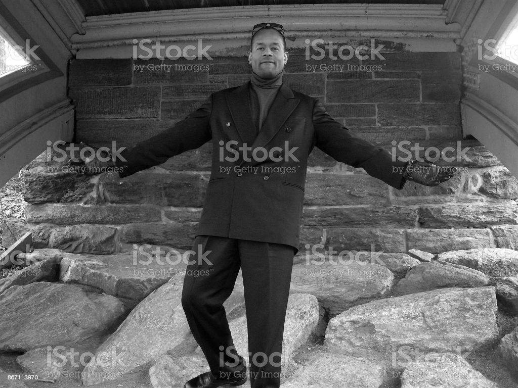 Male Model wearing a business suit & mock turtleneck; Central Park West stock photo