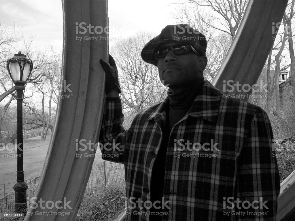 Male Model wearing lumber jacket and hat; Central Park West, New York stock photo