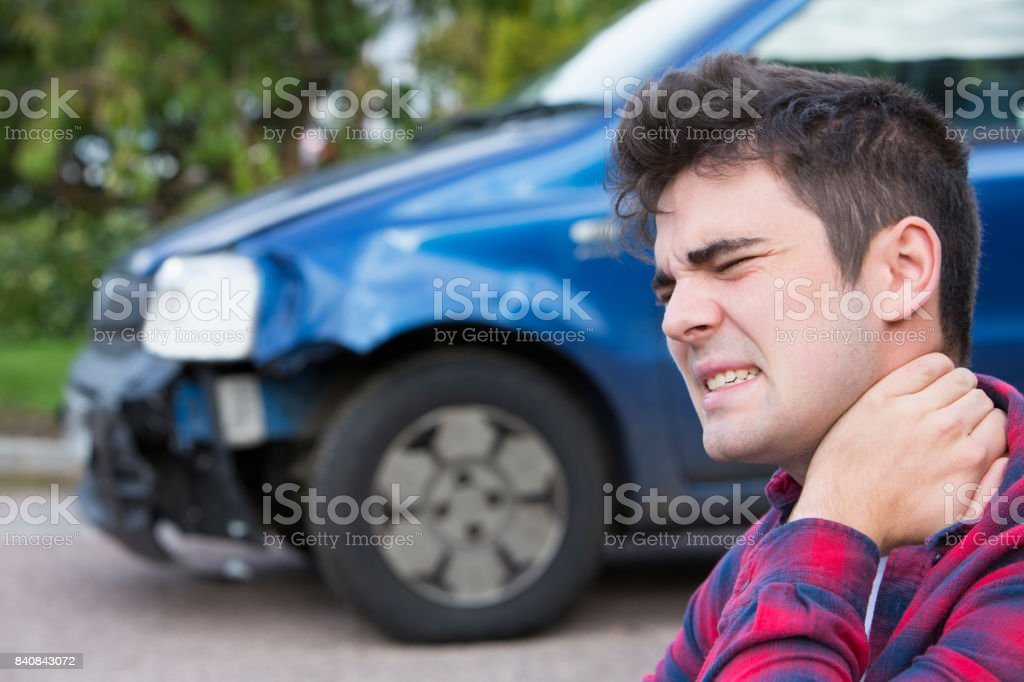 Male Motorist Suffering From Whiplash After Car Accident stock photo