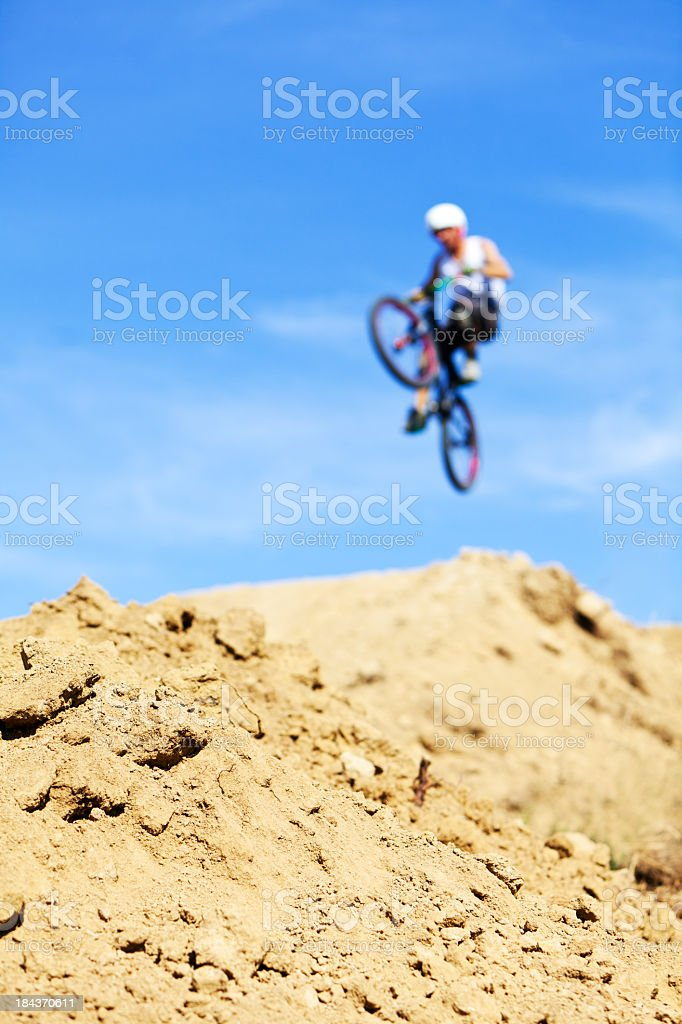 Male Mountain Biker Performing Jump royalty-free stock photo