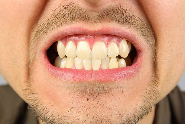 male mouth, tooth grin male mouth, tooth grin, clenched teeth clenching teeth stock pictures, royalty-free photos & images