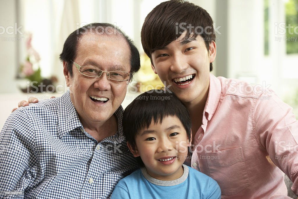Male Multi Genenration Chinese Family Group Relaxing At Home royalty-free stock photo