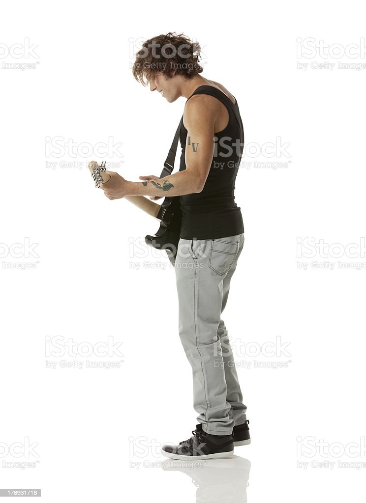 Male musician playing a guitar royalty-free stock photo