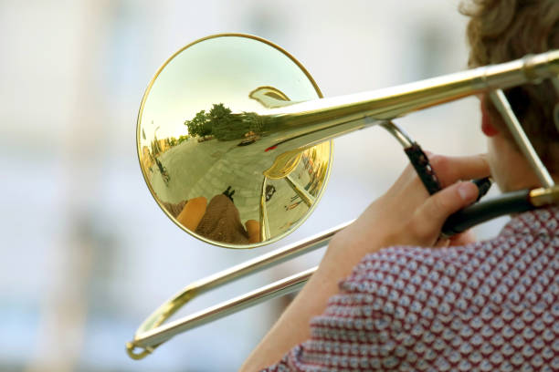 male musician plays the trombone. music and creativity. jazz and Blues stock photo
