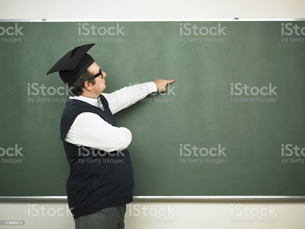Male nerd showing on blackboard royalty-free stock photo