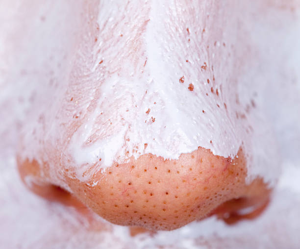 Male nose with purifyng facial mask Male nose with purifyng facial mask human nose stock pictures, royalty-free photos & images