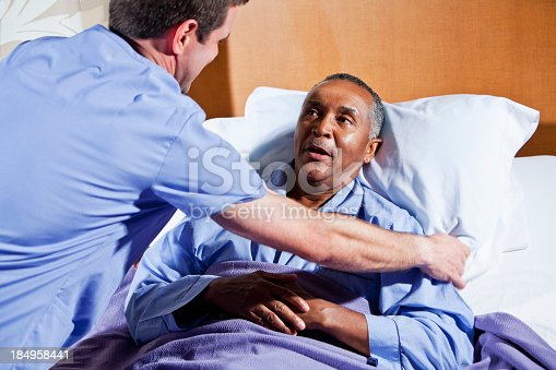 Male Nurse Helping African American Senior Patient Stock -4698