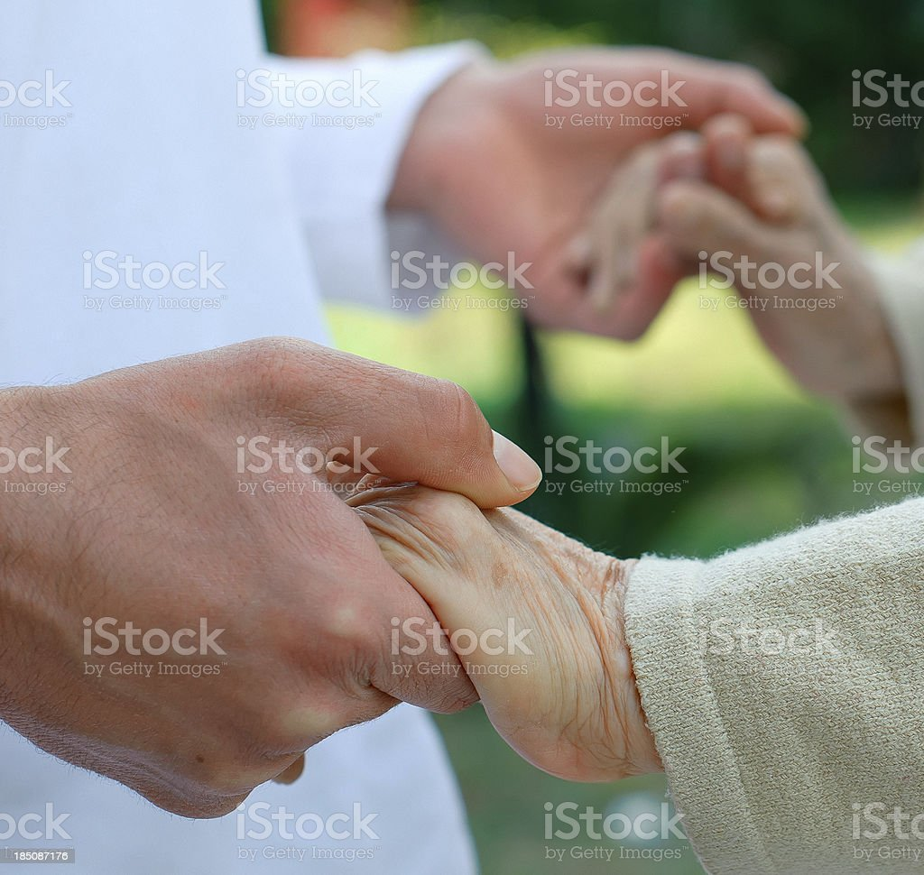 Male Nurse helping to old woman royalty-free stock photo