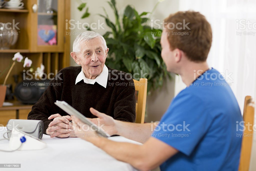 Male Nurse Visiting a Senior Patient royalty-free stock photo