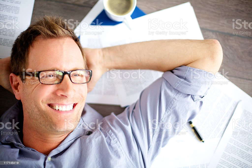 A male office worker lying back - Royalty-free Adult Stock Photo