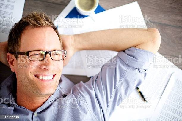 A Male Office Worker Lying Back Stock Photo - Download Image Now