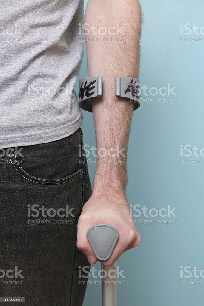 Male on crutches stock photo