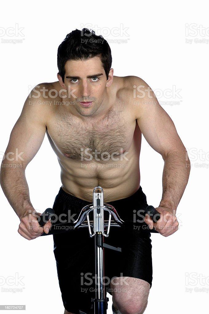 Male on exercise bike royalty-free stock photo