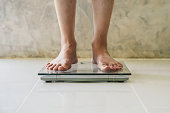 istock Male on weight scale on floor background, Diet concept. 1157854755