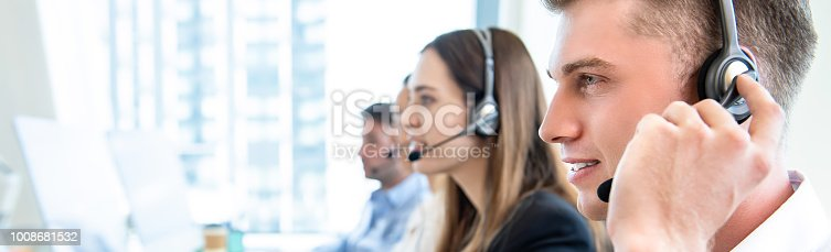 1142008983 istock photo Male operator staff with team working call center 1008681532