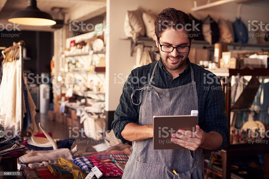 Male Owner Of Gift Store With Digital Tablet stock photo