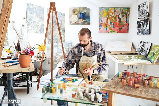 671393252istockphoto Male painer drawing in his studio 514503732