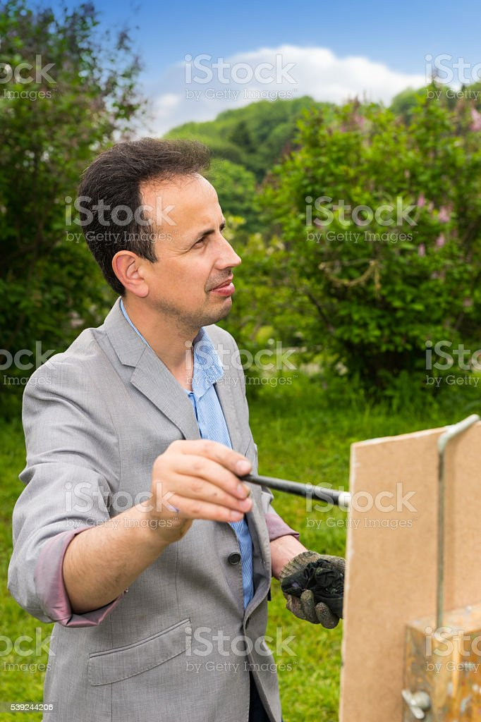 Male painter looking through the park royalty-free stock photo