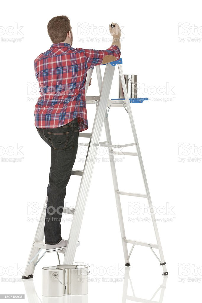 Male painter painting a wall royalty-free stock photo