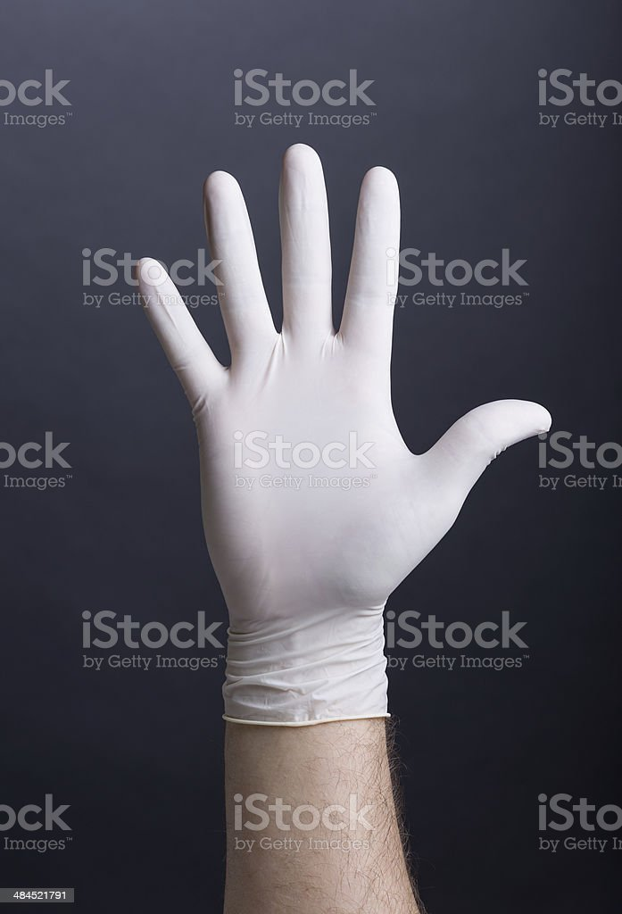 Male palm in latex glove stock photo