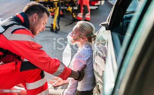 Male Paramedic Helping Injured Woman