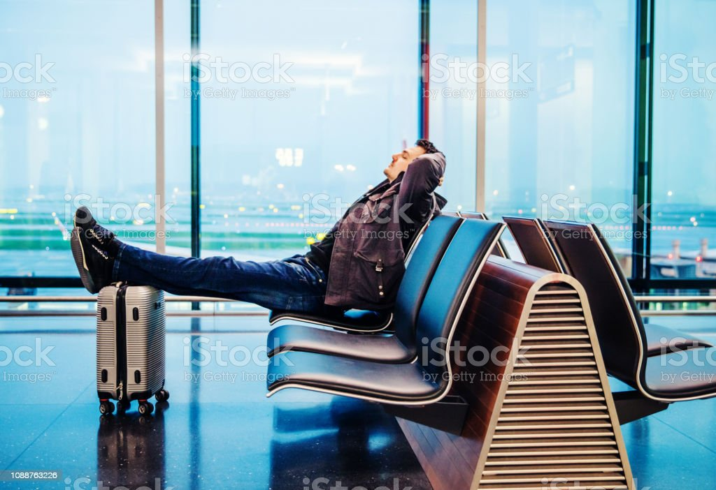Male Passenger Waiting for His Airplane stock photo