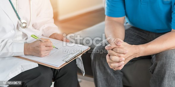 965324772 istock photo Male patient having consultation with doctor or psychiatrist who working on diagnostic examination on men's health disease or mental illness in medical clinic or hospital mental health service center 1029549670