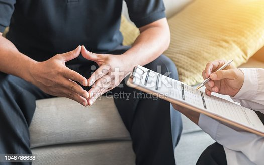 965324772 istock photo Male patient having consultation with doctor or psychiatrist who working on diagnostic examination on men's health disease or mental illness in medical clinic or hospital mental health service center 1046786638