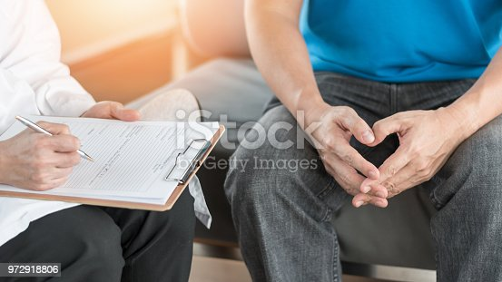 istock Male patient having consultation with doctor or psychiatrist who working on diagnostic examination on men's health disease or mental illness in medical clinic or hospital mental health service center 972918806
